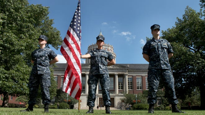 Alexis Anthony, Nicolette Kober and Joshua Schwark, all Naval ROTC students at the University of Rochester, during a vigil held Friday on the campus to mark the anniversary of  9/11.