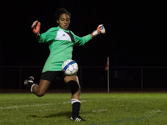 Essex goalie Yasmine Name kicks the ball during the