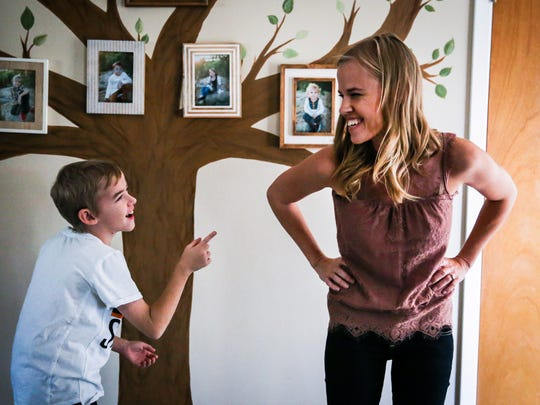 Canyon Martin, 11, and his mother, Ashley Martin, joke