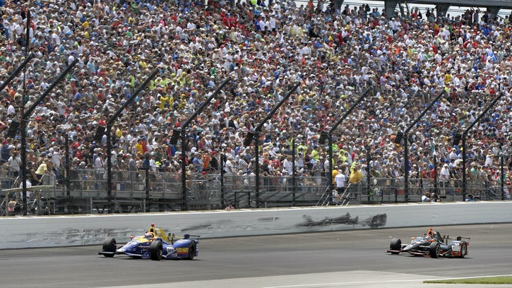 IndyCar Series driver Alexander Rossi (98) races Alex Tagliani (35) during the 100th running of the Indianapolis 500 at Indianapolis Motor Speedway.