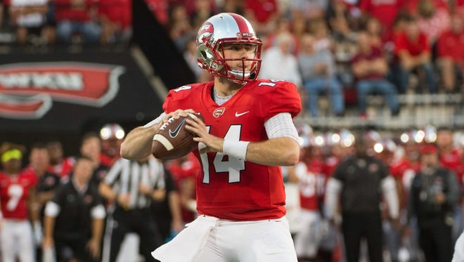 Western Kentucky quarterback Mike White (14) stands in the pocket Sept. 16 at Houchens Industries-L.T. Smith Stadium. The QB threw for five TDs and ran for a score of his own during a victory over Charlotte on Saturday.