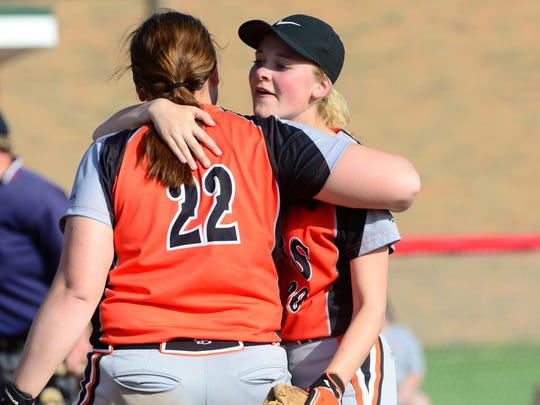 Gibsonburg's Abby Cantrell, left, and Libby Henderson share a hug after a tournament win.