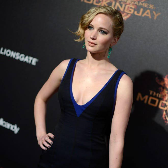 """Jennifer Lawrence appears at the """"Hunger Games: Mockingjay - Part 1"""" party at the 67th international film festival, Cannes, southern France on May 17, 2014 . Lawrence, 24, is speaking out about those nude photos that were stolen via hacking and posted online in an exclusive interview with Vanity Fair for its November issue. The Nov. issue of Vanity Fair goes on sale Oct. 14."""