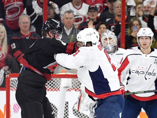 Alex Ovechkin knocks out Andrei Svechnikov during the first period of an NHL playoff game between the Washington Capitals and Carolina Hurricanes.