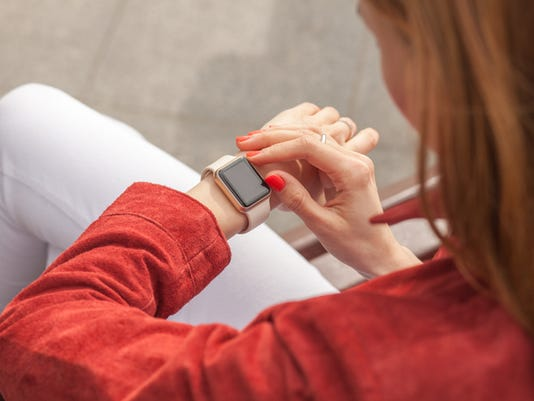 young woman use smart watch with blank screen outdoor