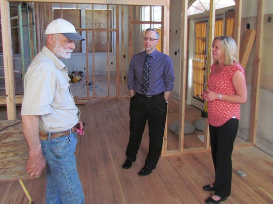 Mike Brash, left, Keith Campbell and Christine Shaffer discuss the city of Stayton's project of building a courthouse in April, 2014.