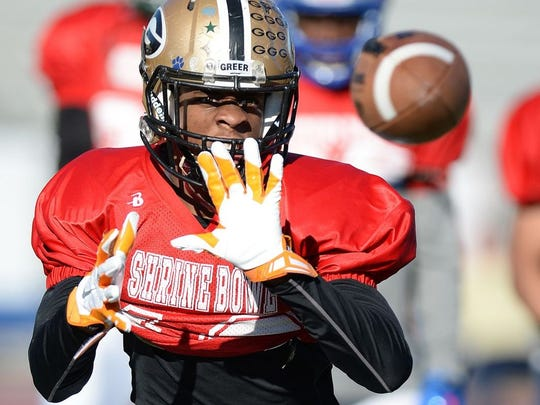 Greer defensive back Troy Pride goes through a drill during Shrine Bowl practice at Spartanburg High School.