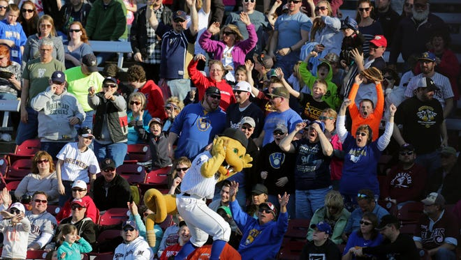 Fang gets fans excited for peanuts as the Wisconsin Timber Rattlers home opener against the Peoria Chiefs takes place at Neuroscience Group Field at Fox Cities Stadium in Grand Chute, Wis., on Sunday, April 12, 2015.