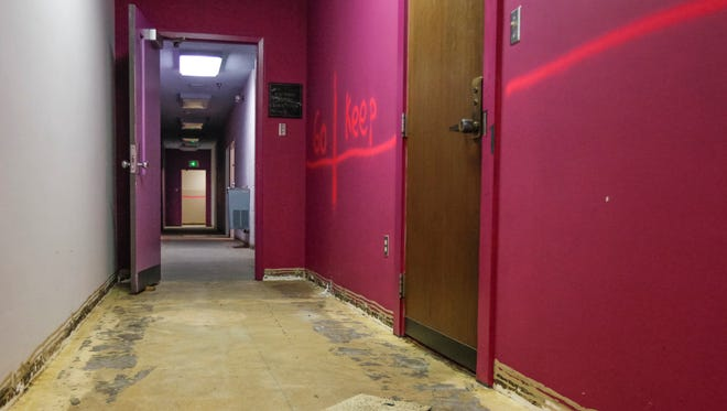 The first step of renovations at Cincinnati Music Hall include new carpeting and bigger office space. Spray paint on the wall marks off instructions for the renovations.