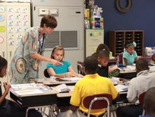 Denise Mooney teaches a science class at Scotts Hill High School.
