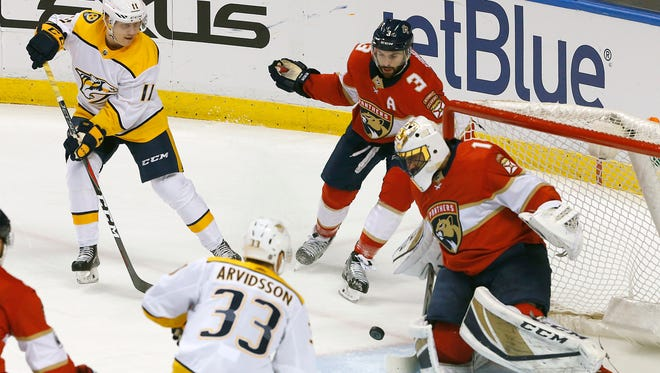 Nashville Predators right wing Eeli Tolvanen (11) has his shot blocked by Florida Panthers goaltender Roberto Luongo (1) in the first period in an NHL hockey game, Tuesday, April 3, 2018, in Sunrise, Fla. (AP Photo/Joe Skipper)