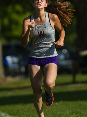 Williamsville's Katherine Walker wins the girls race during a Sangamo Conference triangular cross country meet between Pleasant Plains, Riverton and Williamsville High Schools at Lincoln Park in Springfield, Saturday, Aug. 28, 2020.