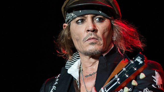 Johnny Depp plays with his band, the Hollywood Vampires, on June 20 in London.