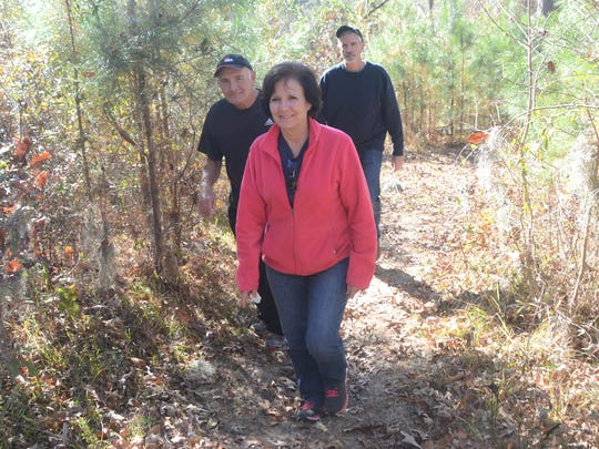 ANI Kisatchie Trail Maintenance Valli Peacher (front), Paul Brand and Paul Turregano are cyclists who use and voluntarily maintain the trails in the Kisatchie Forest. The Kisatchie Forestry Service held a meeting Tuesday, Dec. 9, 2014 to discuss trail maintenance and volunteer maintenance assistance.-Melinda Martinez/mmartinez@thetowntalk.com