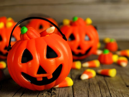 Halloween Jack o Lantern candy holders close up on wood