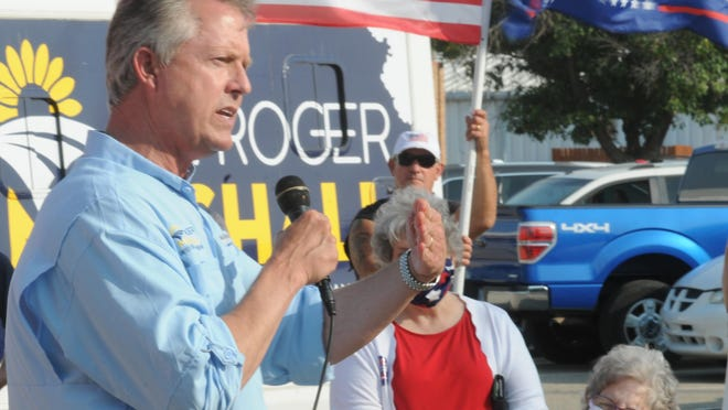 Incumbent U.S. Rep. Roger Marshall, a Republican, speaks to a crowd of about 75 community members during Marshall's Keep Kansas Great Bus Tour stop at the Tony's Pizza Events Center parking lot on Monday.