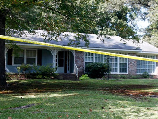 Police crime scene tape surrounds the residence of two Catholic nuns who worked as nurses and helped the poor in rural Mississippi, and were found slain in their Durant, Miss., home Thursday, Aug. 25, 2016. Authorities said there were signs of a break-in and their vehicle was missing. (AP Photo/Rogelio V. Solis)