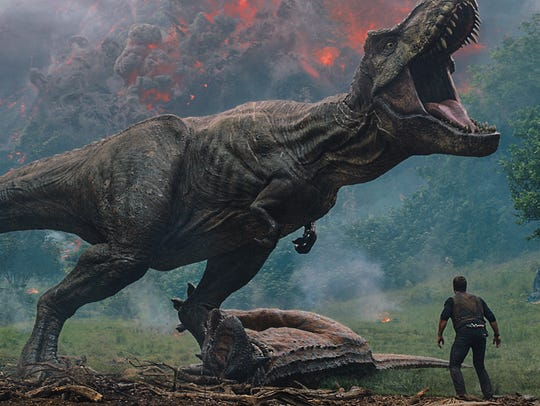 "Owen (Chris Pratt) meets a T. rex in ""Jurassic World:"
