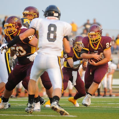 Harrisburg's Jacob Klemme, right, rushes with the ball