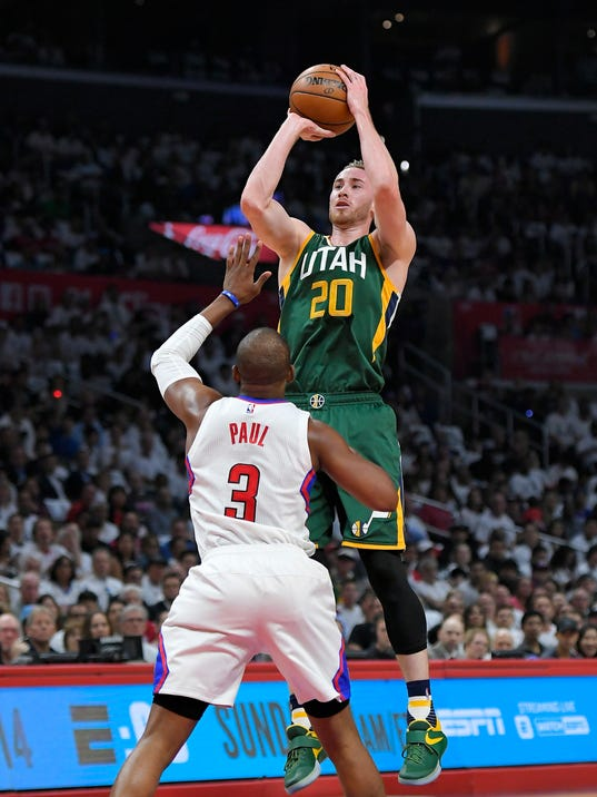 Utah Jazz forward Gordon Hayward, top, shoots as Los Angeles Clippers guard Chris Paul defends during the first half in Game 7 of an NBA basketball first-round playoff series, Sunday, April 30, 2017, in Los Angeles. (AP Photo/Mark J. Terrill)