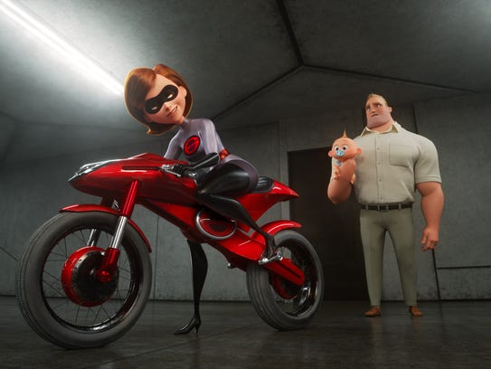 """—TAKING THE WHEEL -- In """"Incredibles 2,"""" Helen, aka Elastigirl, is called on to help bring Supers back. Her mission comes with a new Elasticycle, a state-of-the-art cycle designed just for her. Meanwhile, Bob navigates the day-to-day heroics of """"normal"""" life at home. Featuring the voices of Holly Hunter and Craig T. Nelson, Disney•Pixar's """"Incredibles 2"""" busts into theaters on June 15, 2018. ©2018 Disney•Pixar. All Rights Reserved"""