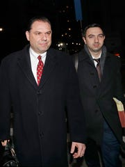Joseph Percoco, left, Gov, Andrew Cuomo's former executive deputy secretary, leaves U.S. District Court with one of his attorneys after appearing in his federal bribery trial, Thursday, Feb. 1, 2018, in New York.