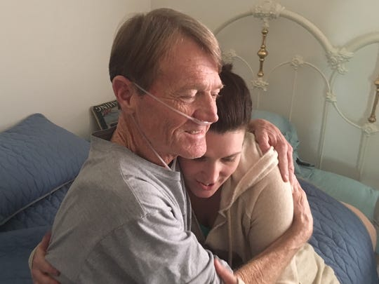 Doug Carlson hugs his daughter, Rachel, in a 2017 photo. Carlson died on Aug. 10 of pancreatic cancer.