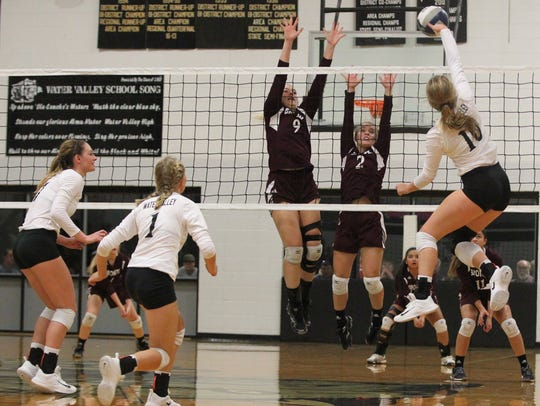 Water Valley's Chesney Baker (10) tries to get the ball past the net defense of Bronte's Alyssa Sallee (9) and Jayden Speary (2) during a District 7-2A volleyball match Tuesday, Oct. 3, 2017, in Water Valley.