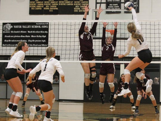Water Valley's Chesney Baker (10) tries to get the ball past the net defense of Alyssa Sallee (9) and Jayden Speary (2) during a District 7-2A volleyball match Tuesday, Oct. 3, 2017, in Water Valley.