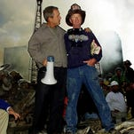 President Bush and a firefighter in front of the rubble of the New York World Trade Center in 2001.