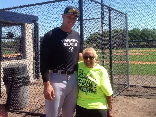 Flo Tripi with New York Yankee Aaron Judge at spring training in Florida last year.
