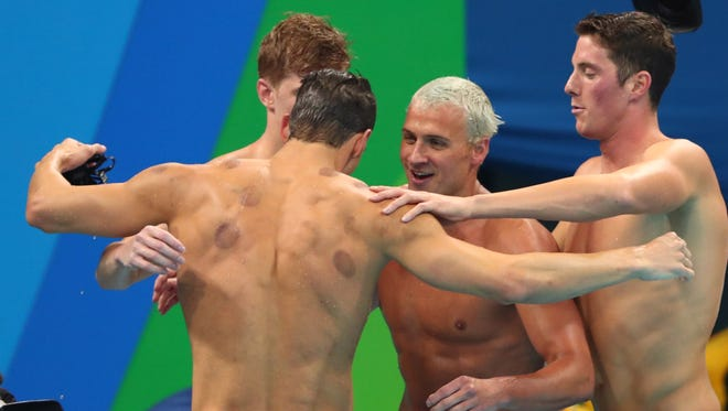 Conor Dwyer (USA) , Townley Haas (USA) , Ryan Lochte (USA) and Michael Phelps (USA) celebrate after winning the men's 4x200m freestyle relay final in the Rio 2016 Summer Olympic Games at Olympic Aquatics Stadium.