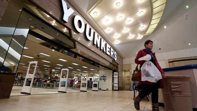 A shopper leaves Younkers store Wednesday, Jan. 31, 2018, in the Wausau Center mall in Wausau, Wisc.