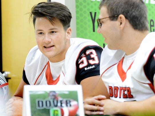 Dover's Chase Heath, left, and Shad Murphy talk to reporters at the York-Adams Football Media Day at the York Newspaper Company Tuesday, Aug. 1, 2017. Heath was named the York-Adams League Division II Defensive Player of the Year. YORK DISPATCH FILE PHOTO