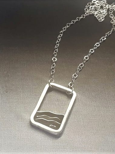 A necklace depicting waves made by Marjorie Bryan.