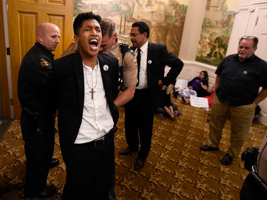Justin Jones is arrested by state troopers in the governor's office as he and others stage a sit in Medicaid expansion Tuesday, April 11, 2017 at the State Capitol  in Nashville, Tenn.