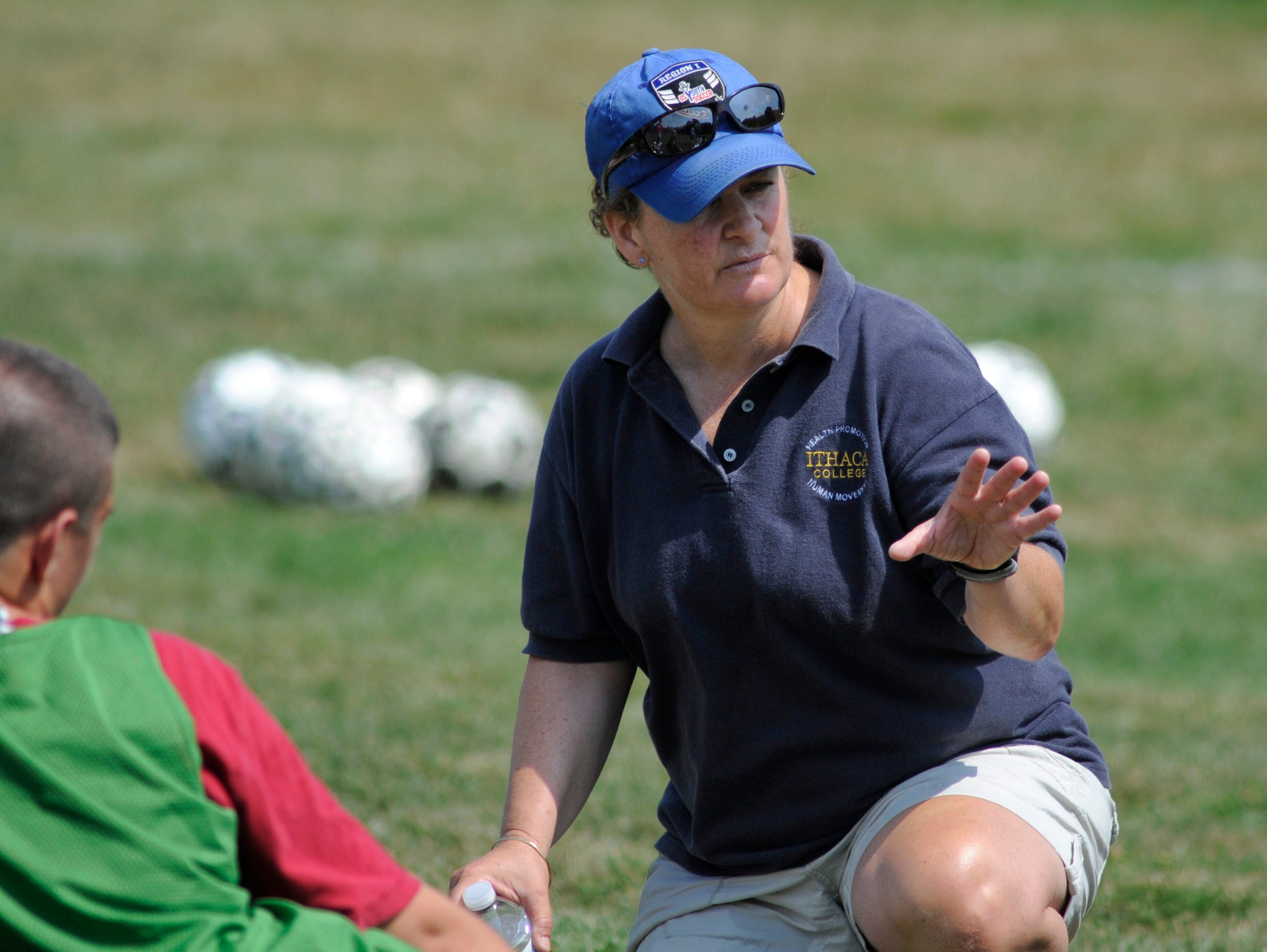 Highland High School first-year boys' varsity soccer coach Terri Cilento instructs during practice on Wednesday in Lloyd.