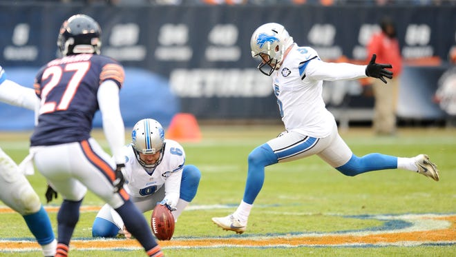 Lions kicker Matt Prater stretches out, heading toward the ball, on his 59-yard field goal that sails through for three points to end the first half.