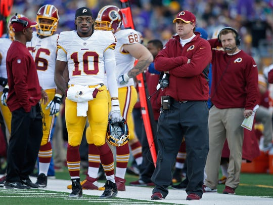 Redskins quarterback Robert Griffin III (10) and head coach Jay Gruden on the sidelines during a timeout in the game with the Minnesota Vikings at TCF Bank Stadium.