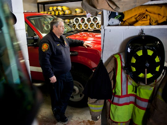 Kimball Fire Chief Ed Gratz is surrounded by parked trucks and equipment as he talks about the need to upgrade and expand Kimball Fire Station 1. The township has purchased an adjacent lot and plans to remodel and expand are moving forward.