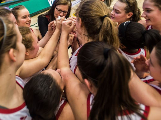 CVU girl's basketball coach Ute Otley huddles with her team  after they beat Mt. Anthony to win their DI semifinal at UVM's Patrick Gym in Burlington on Thursday night, March 16, 2017. They will face St. Johnsbury in the Vermont State Championship on Saturday.