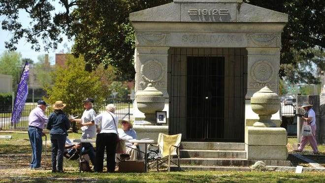 """Visitors tour St. Michael's Cemetery Saturday during Get in the Spirit presented by The University of West Florida and St. Michael's Cemetery Foundation of Pensacola. The purpose of """"Get in the Spirit"""" is to raise awareness of the conservation and preservation needs of the cemetery."""