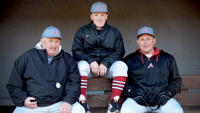 Three generations of the Hillier family are together this season in the Asheville High baseball team's dugout. From left to right, assistant coach Bill Hillier Sr., freshman Three Hillier and head coach Bill Hillier Jr.
