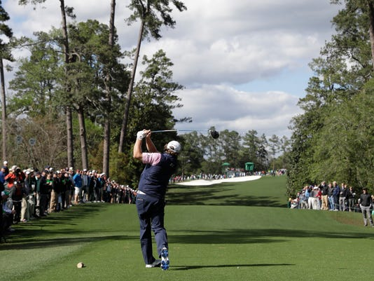 Will McGirt hits a drive on the 18th hole during the first round for the Masters golf tournament Thursday, April 6, 2017, in Augusta, Ga. (AP Photo/David J. Phillip)