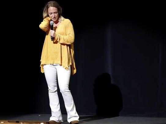 Darcy Schehr speaks to a crowd of high school students
