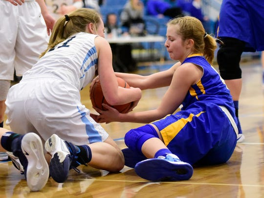 Clyde's Heidi Marshall, right, and Lake's Kayla Bekier fight over the ball Thursday.