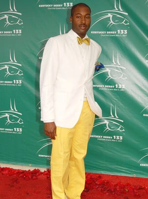 In this May 5, 2007 file photo, Mychael Knight arrives at the 133rd Kentucky Derby at Churchill Downs in Louisville, Ky. Knight, who was a finalist on the popular competition show 'Project Runway,' has died at age 39.