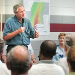 President George W. Bush talks to a group of Mississippi officials about hurricane relief Monday Sept.5, 2005, at Pearl River Communtity College in Poplarville.