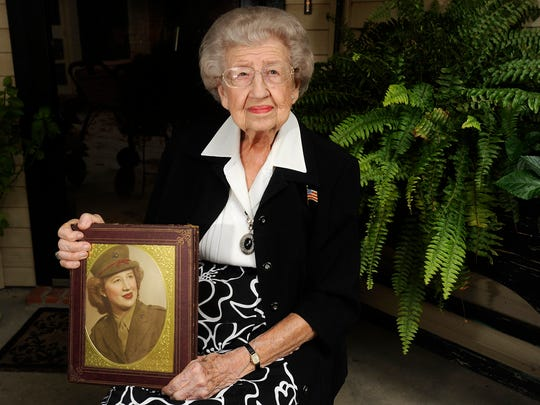 U.S. Marine Corps veteran Ellen Webb displays a photograph of herself from 1945. Webb was grand marshal of the 2016 Veterans Day parade in  Abilene.