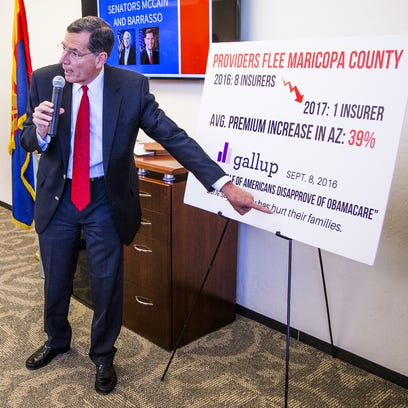 """Arizona voters' feelings about the Affordable Care Act remain sharply divided, a new poll shows. Here, Sen. John Barrasso of Wyoming conducts a town hall on """"Obamacare"""" at the Phoenix Better Business Bureau in September 2016."""